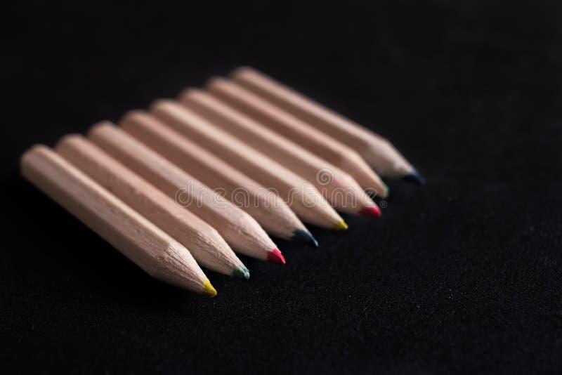 карандаши предпосылки покрашенные чернотой стоковое изображение