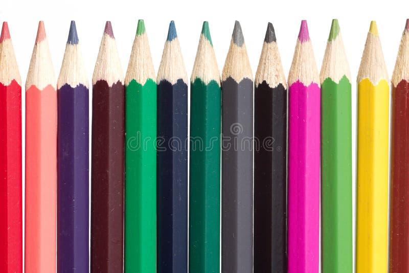 карандаши цвета inline изолированные белые стоковые изображения