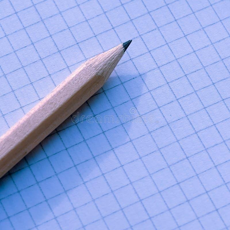 Карандаш и тетради конец вверх стоковое изображение