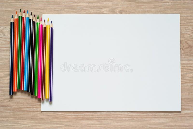 Карандаши и лист альбома стоковая фотография rf