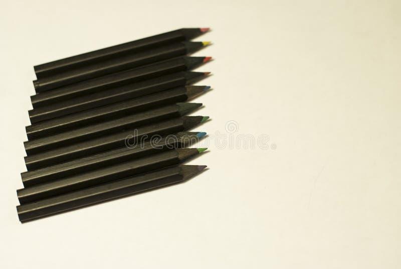 Карандаши покрашенные чернотой на белой предпосылке стоковое изображение rf