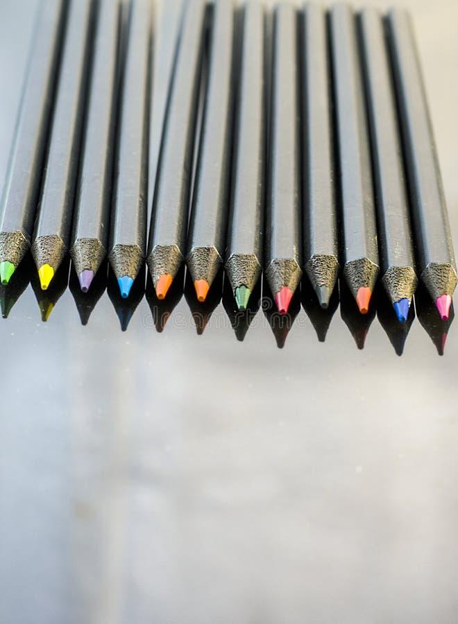 карандаши предпосылки покрашенные чернотой стоковая фотография