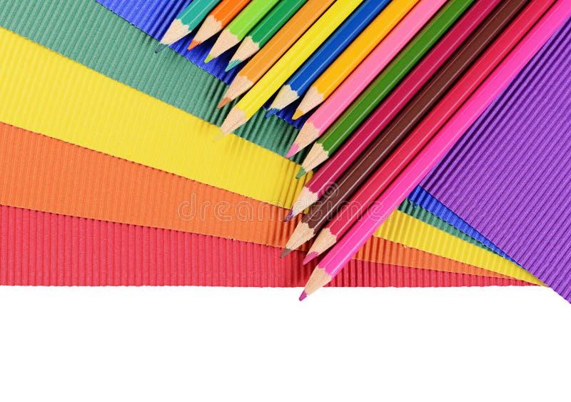 Карандаши цвета на пестротканой бумаге стоковое изображение