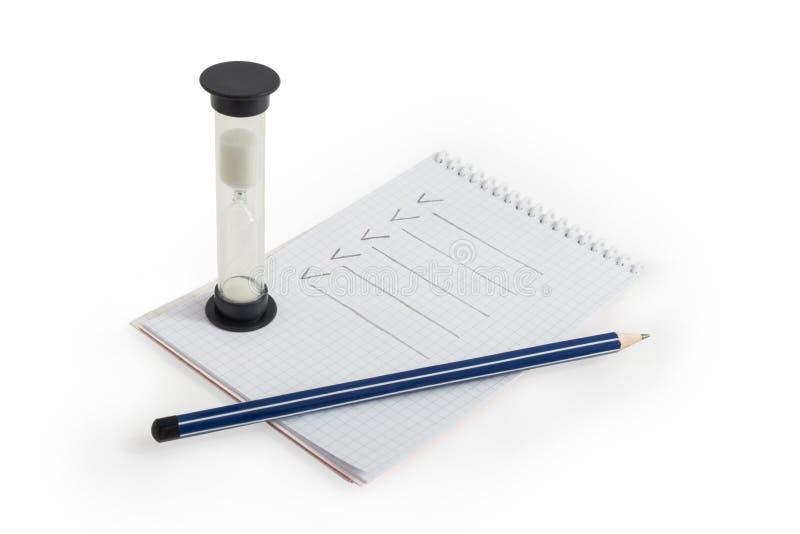 Карандаш, тетрадь и часы стоковые изображения rf