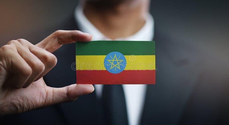Карта удерживания бизнесмена флага Эфиопии стоковое изображение rf