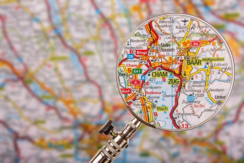 Карта Cham Zug Baar с лупой на таблице стоковые изображения
