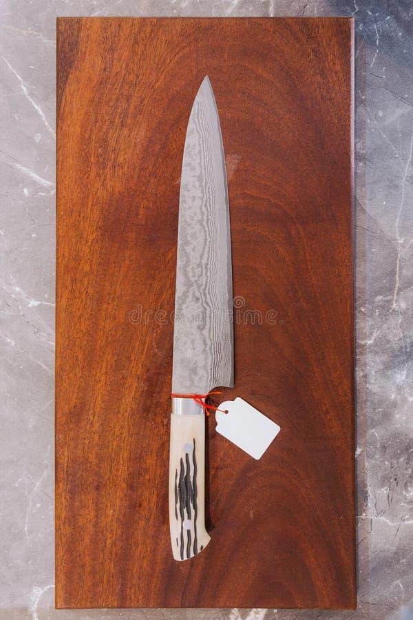 Картина волны с пустым ценником, текстура лезвия нержавеющей стали ножа японского повара кухонного ножа стиля Дамаска стоковое изображение rf