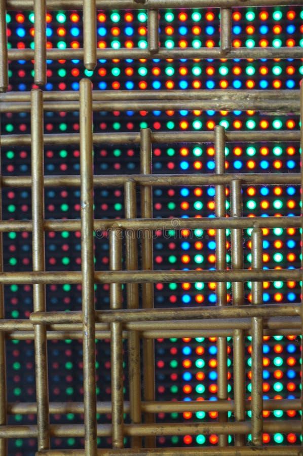 Картина золотой стальной трубки с предпосылкой светоизлучающего диода стоковое фото rf