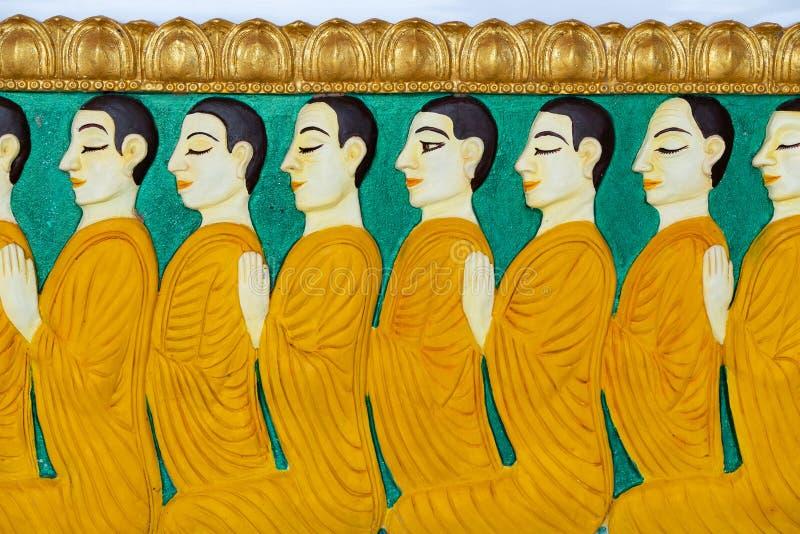 Картина монаха на стене штукатурки стоковые фотографии rf