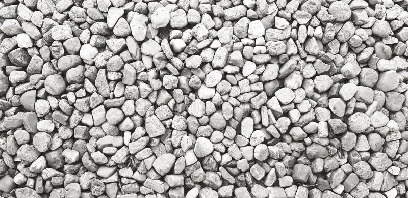 Картина небольших гравия, утеса или камня на том основании для предпосылки в черно-белом тоне цвета стоковое фото