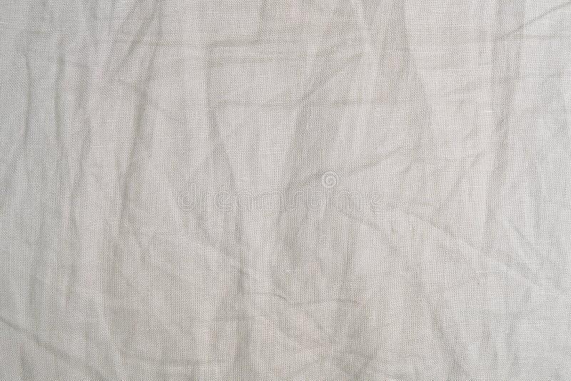 Картина предпосылки скомканной бежевой текстуры ткани стоковые изображения