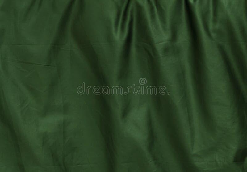 Картина предпосылки скомканной зеленой текстуры ткани стоковые изображения rf