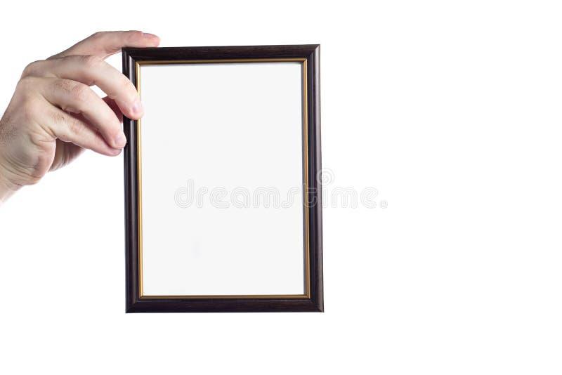 Картинная рамка удерживания руки изолированная на белой предпосылке стоковая фотография