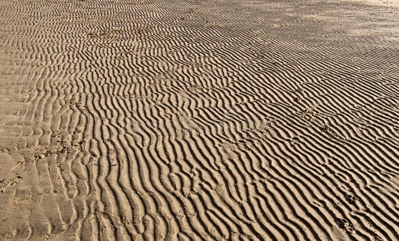 Картины в песке на пляже стоковая фотография
