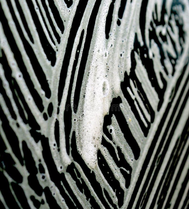 картины пены мойки на окне автомобиля стоковые изображения
