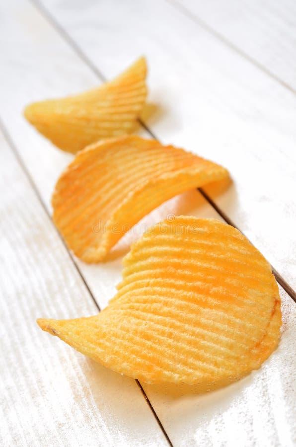 Картофельные стружки стоковые фотографии rf