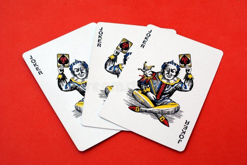 карточки играя в азартные игры игра чешет играть шутника стоковые фото