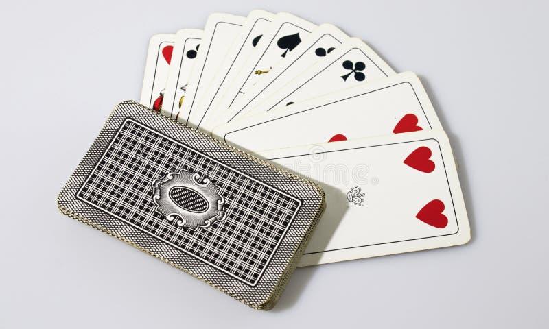 Карточки игры в белой предпосылке стоковые фотографии rf