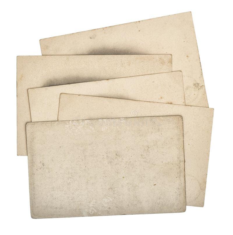 Карточки используемые кучей бумажные изолировали белую предпосылку стоковая фотография