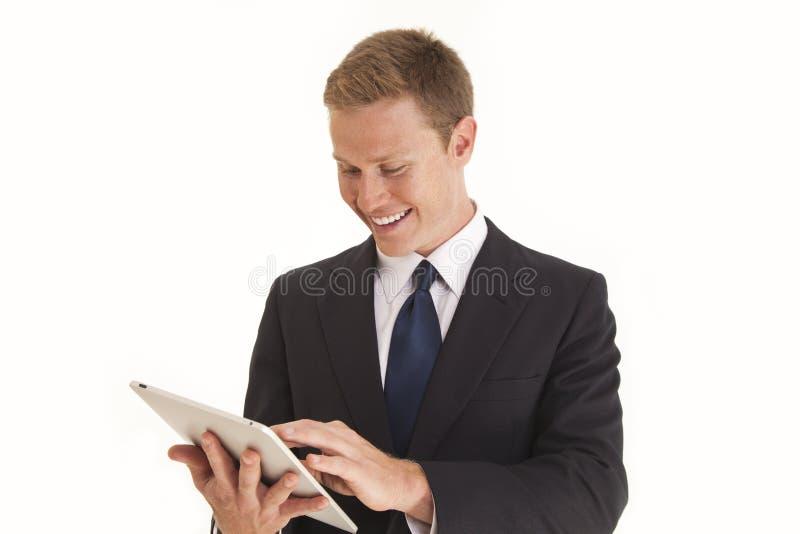 касание таблетки экрана компьютера бизнесмена используя стоковая фотография
