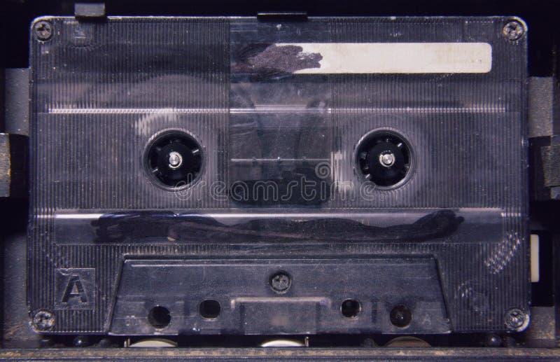 Кассета в игроке 90s поцарапала стоковые изображения