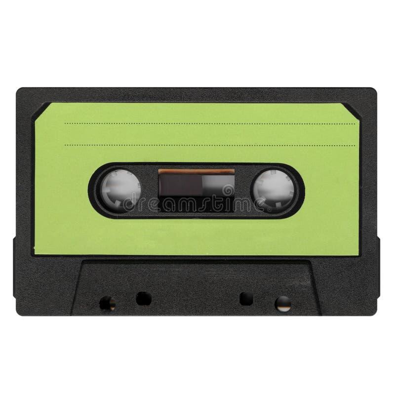 кассета магнитной ленты при зеленый ярлык изолированный над белизной стоковое изображение rf