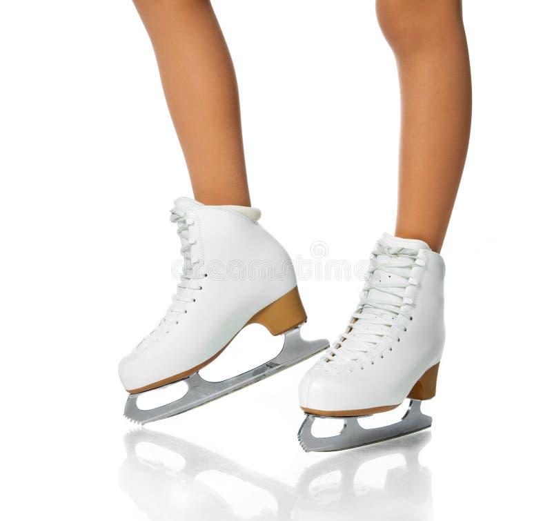 кататься на коньках ног льда девушок стоковые фотографии rf