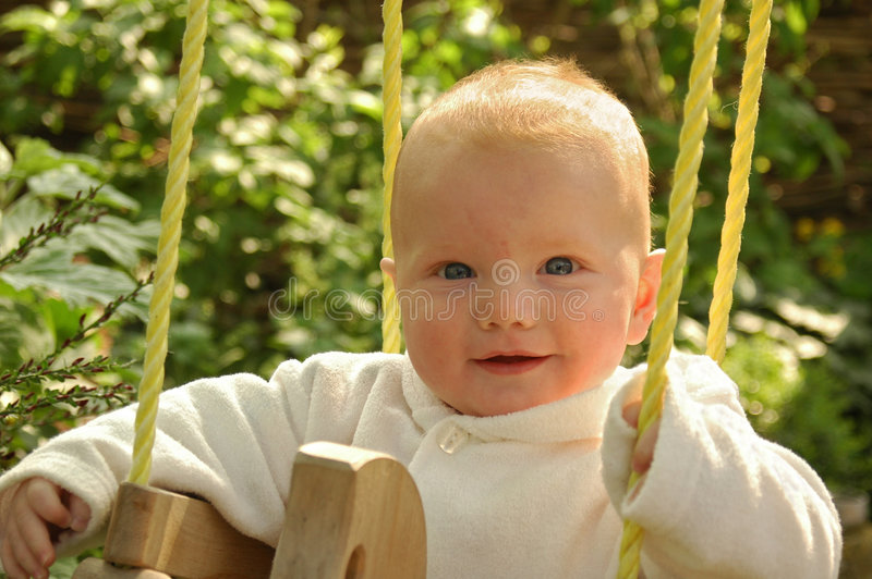 качание младенца стоковое фото rf