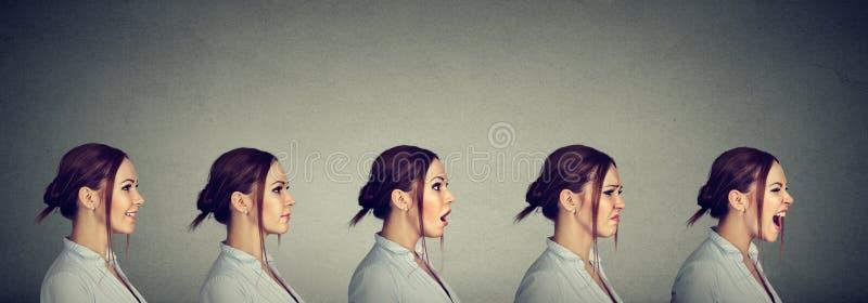 Качание настроения Молодая женщина выражая различные эмоции и чувства стоковые фотографии rf