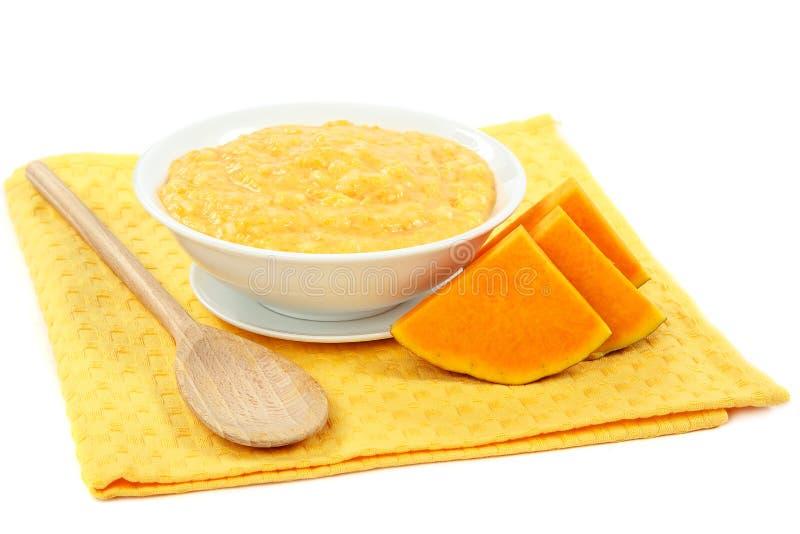Каша тыквы на белой предпосылке еда здоровая стоковые изображения