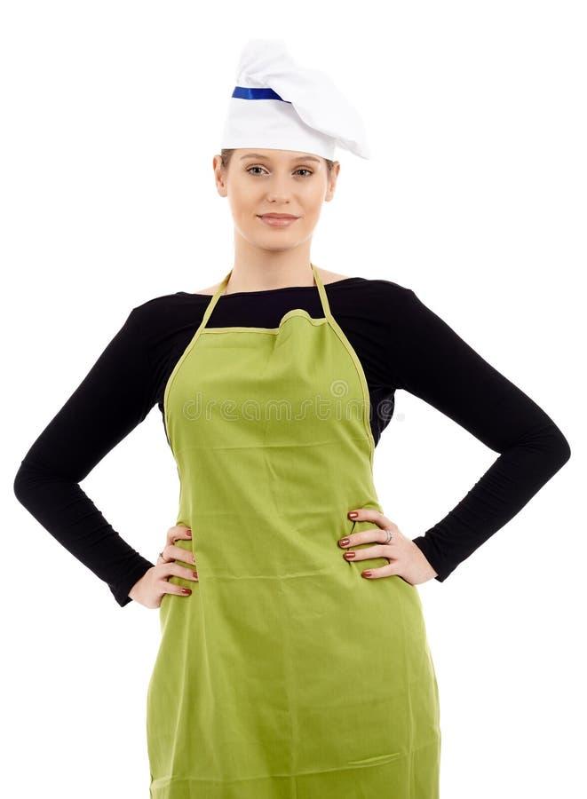 Кашевар молодой женщины изолированный на белизне стоковое фото