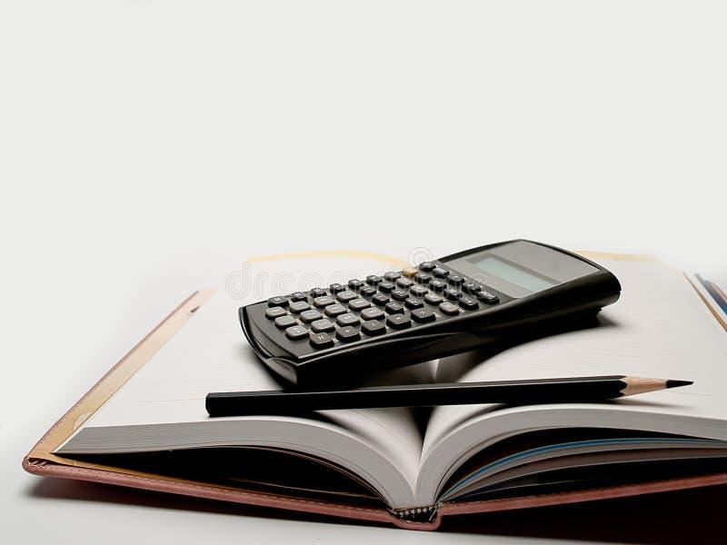 Калькулятор, и дневник стоковые фотографии rf