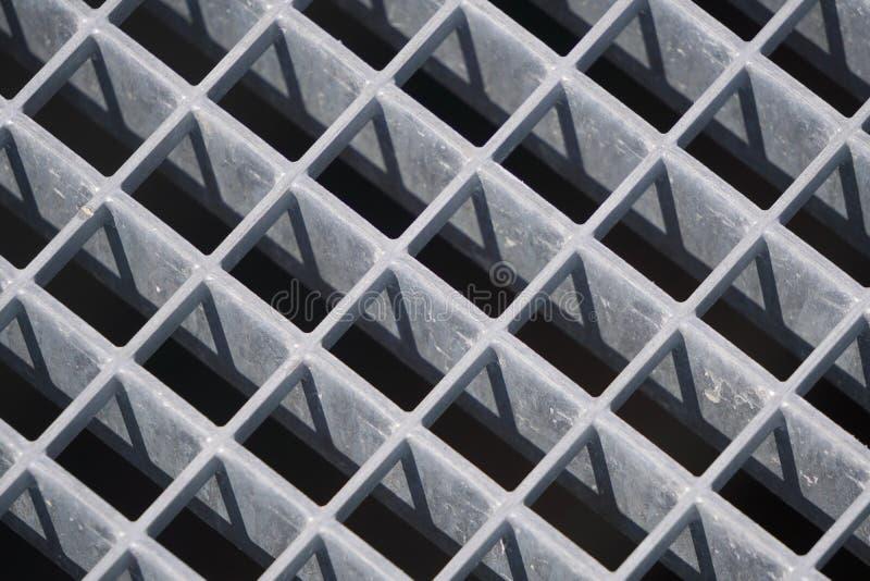 Квадратная геометрия железобетонных плит, крепкие решетки воспроизведение света и тени, скринсавер, фон фон диагональной решетки стоковая фотография