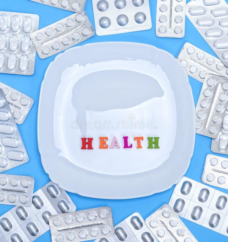 Квадратные белые керамические плита и надпись здоровья стоковое изображение