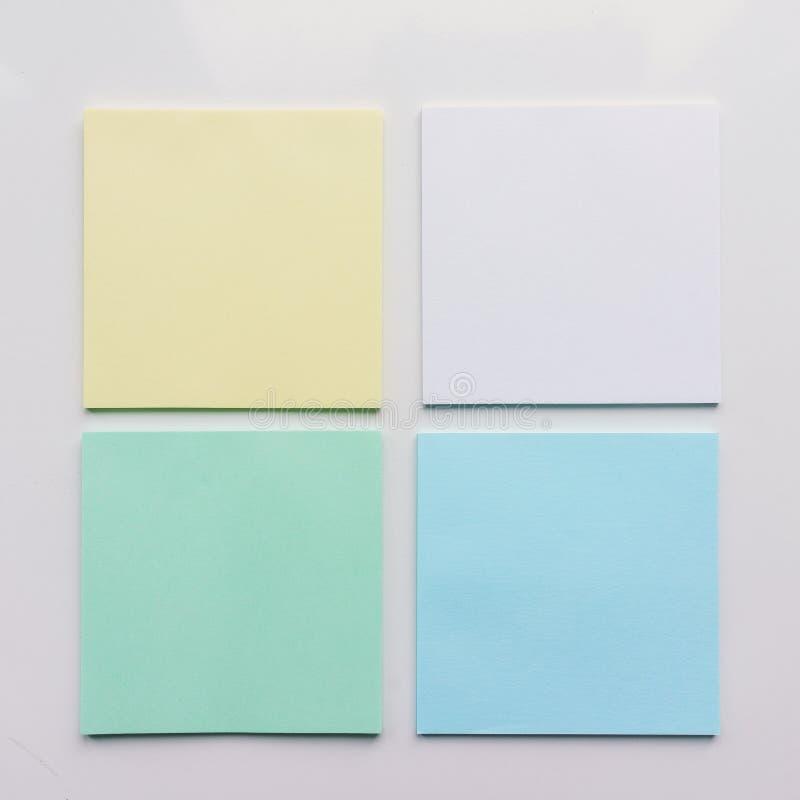 Квадратный лист бумаги 4 на белой предпосылке Взгляд сверху Конец-вверх бесплатная иллюстрация