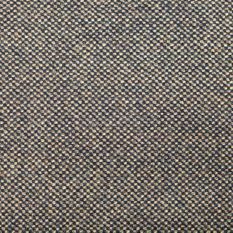 Квадратная предпосылка от зеленой коричневой ткани одежды из твида стоковые фотографии rf