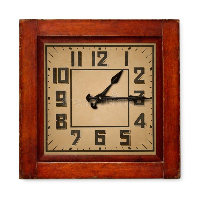 Квадратные деревянные настенные часы стоковое фото