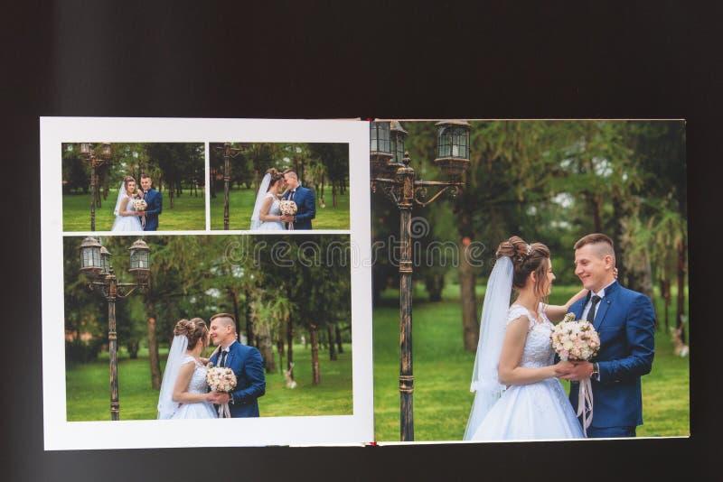 Киев, Украина 15-ое мая 2019 вызывает photobook свадьбы или альбома свадьбы на черной предпосылке стоковая фотография rf