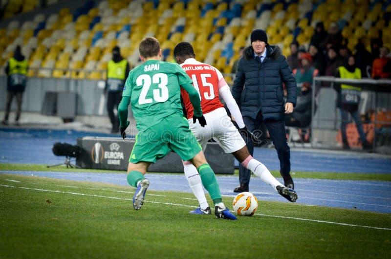 КИЕВ, УКРАИНА - 29-ое ноября 2018: Ainsley Maitland-Niles во время матча лиги Европы UEFA между Vorskla Полтавой против FC стоковые фото