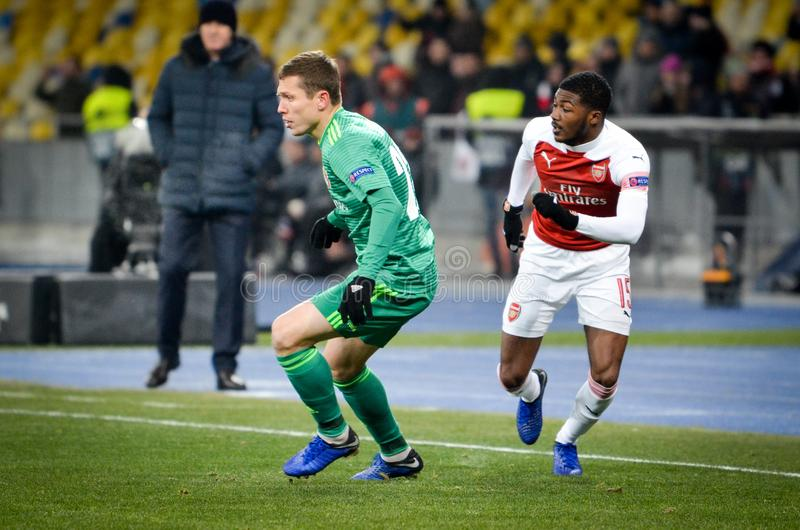 КИЕВ, УКРАИНА - 29-ое ноября 2018: Ainsley Maitland-Niles во время матча лиги Европы UEFA между Vorskla Полтавой против FC стоковое фото rf