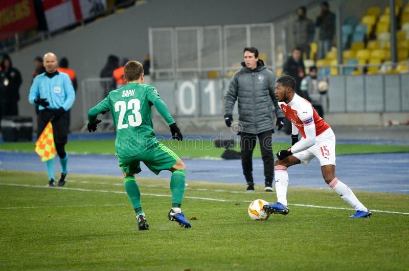 КИЕВ, УКРАИНА - 29-ое ноября 2018: Ainsley Maitland-Niles во время матча лиги Европы UEFA между Vorskla Полтавой против FC стоковые фотографии rf