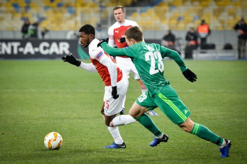 КИЕВ, УКРАИНА - 29-ое ноября 2018: Ainsley Maitland-Niles во время матча лиги Европы UEFA между Vorskla Полтавой против FC стоковые изображения rf