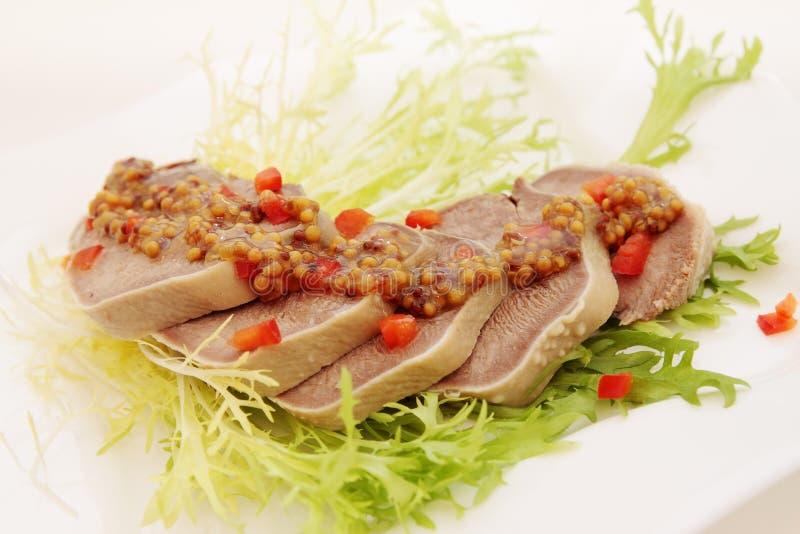 Кипеть язык свинины стоковое фото rf