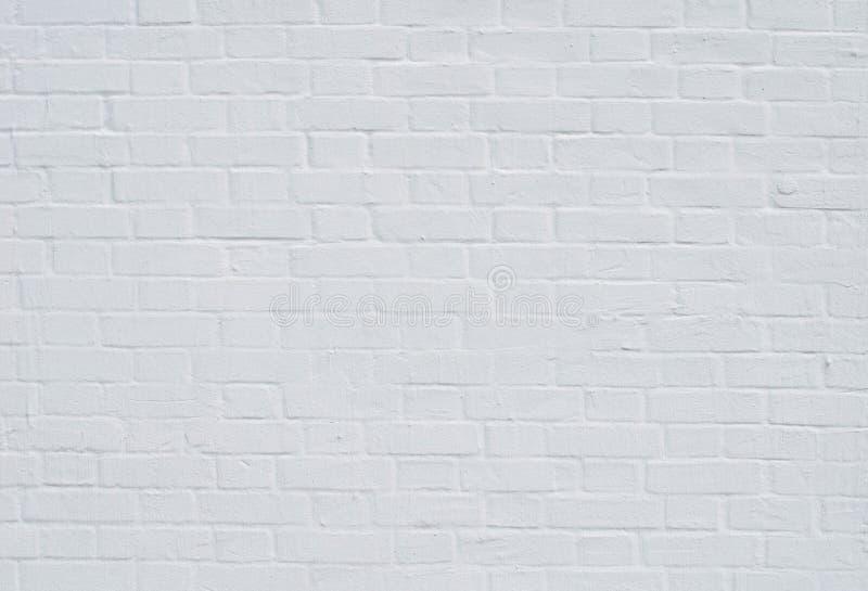 Кирпичная стена с белым беля концом вверх стоковые фотографии rf