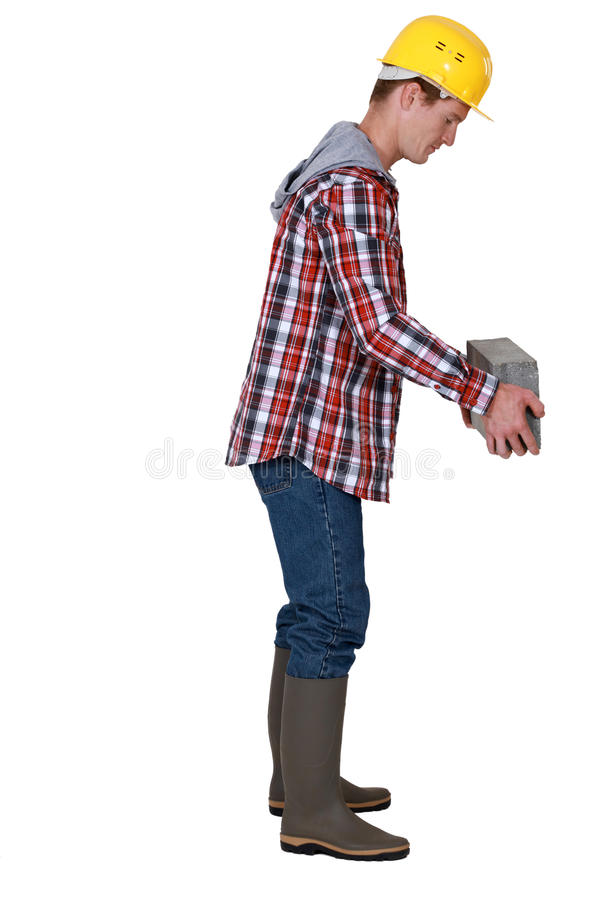 Кирпич каменщика поднимаясь стоковые фотографии rf