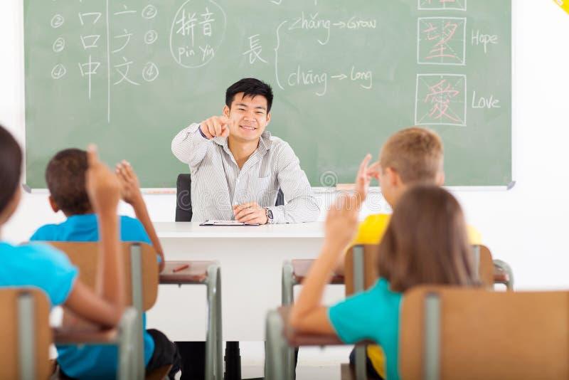 Китаец учителя уча стоковая фотография