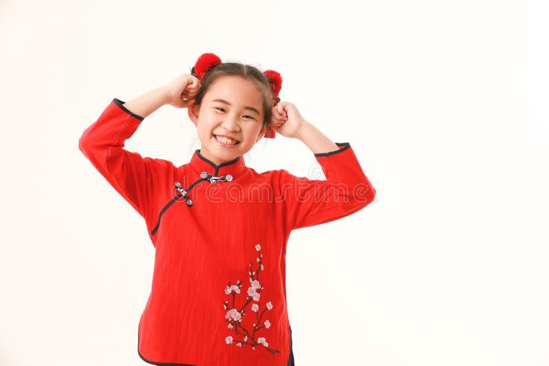 Китайская девушка на белой предпосылке стоковые изображения