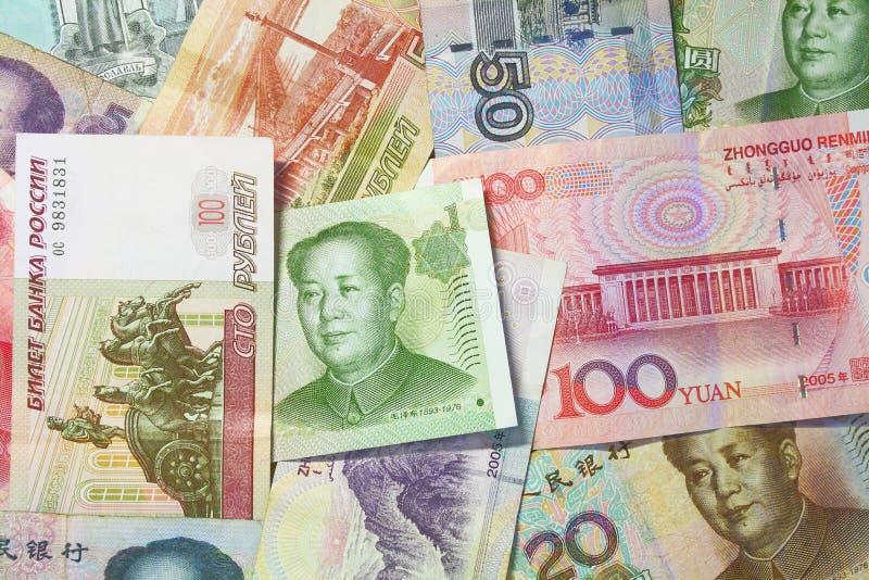 Китайская и русская валюта стоковые изображения