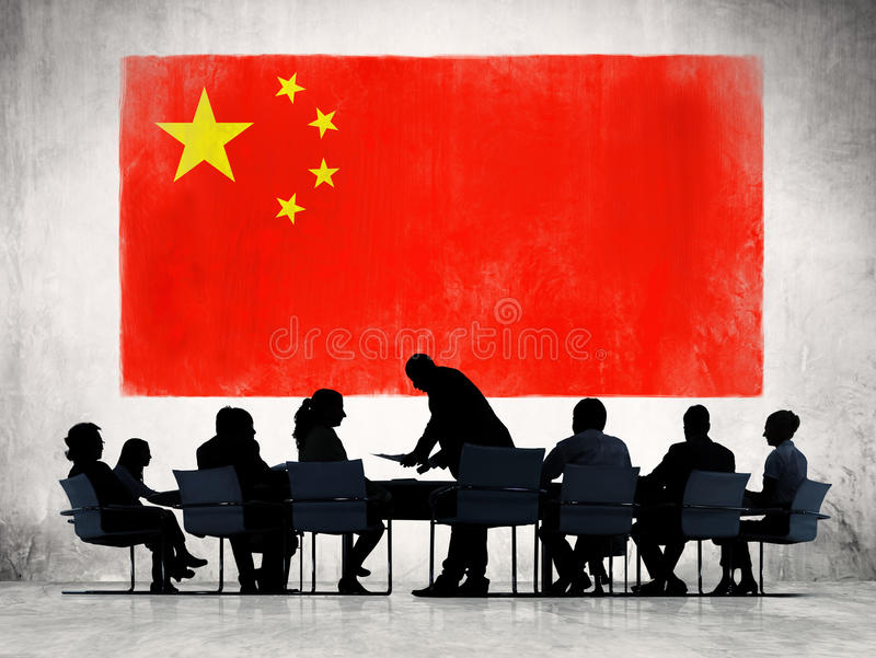 Китайские бизнесмены в встрече стоковое фото rf