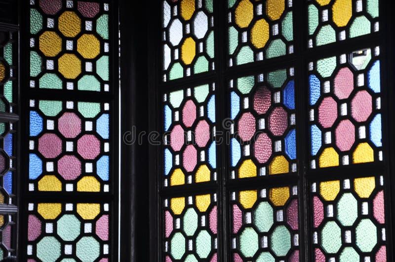 Китайские стародедовские стеклянные окна стоковые фото